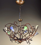 Schizzo Design Chandelier With Hand Bent Arms And Blown Glass